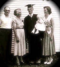 My Dad at his U of I graduation. He is holding me instead of his diploma.