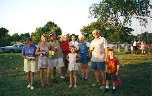 A group of Petersons and Henrys dig the Fair sometime in the 90s. Sick-inducing Swing Ride visible in right background