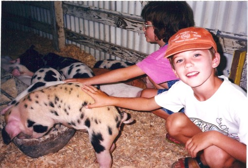 The Child (with Cousin) demonstrating an early livestock appreciation at the Clark County Fair