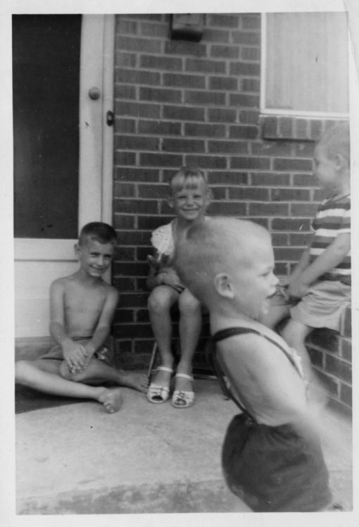 That's me, wearing white sandals (of course; it's summer!) with a couple of brothers and a cousin. Back when summer -- and childhood -- went to infinity and beyond.