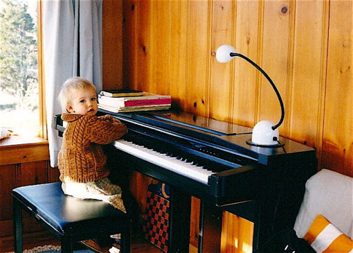 Let's pause for yet another adorable Child-at-Piano pic. Yes, I did indeed knit that sweater